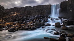 Oxararfoss waterfall - Thingvellir, Iceland - Travel photography (Giuseppe Milo (www.pixael.com)) Tags: iceland landscape waterfall travel nature water longexposure sky thingvellir photography clouds oxararfoss rocks southernregion is onsale