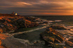 Late Evening at the Cove (Walter Levin) Tags: newengland rhodeisland evening sunset sunlight shadows clouds colorful rocks waves lighthouse cove coast ocean landscape sky 5d4