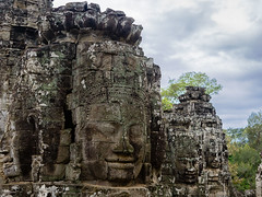 Faces in the Ruins (Ron Scubadiver's Wild Life) Tags: temple ruins angkor wat sky rocks nikon 24120 clouds trees