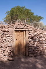 Door in cactus wood (Flo Guichard) Tags: san pedro de atacama chile desert city town mud architecture typical travel tourism touristic sun sunny day outdoors door cactus wood wall stones street tree