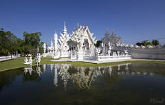 The magnificent and unconventional, White Temple (Wat Rong Khun) in Chiang Rai, Thailand. (PJEnsell) Tags: white temple buddhist lake reflection bridge tribute faith religion worship buddhism thailand wat rong khun travelphotography travel wonder beauty wander architecture design building palace