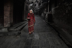 on the way to pray (still very busy, trying to catch up) Tags: woman oldman nepali nepaliwoman streetphotography streetlife bhaktapur morning
