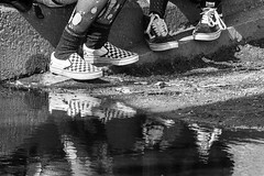 Fishnet and puddle (RaminN) Tags: fishnet puddle reflection shoes monochrome