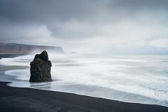 After the Rain (andy in nyc) Tags: iceland ísland suðurland southcoast dyrhólaey cliffs beach blacksand waves longexposure leebigstopper clouds reynisdrangar geotagged
