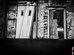 Abandoned Building (BigRedTroll) Tags: abandoned architecture bw blackandwhite brick building crumbling decay decayed decaying derelict door forgotten grunge material monochrome old slum structuralelement structure unloved wall worn