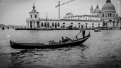 Gondolier (Ivan I. Ossandon) Tags: venice italy white black italia sony trails gondola alpha venecia gondoliers slta77