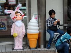 Creepy mascot (iainwalker) Tags: pink rabbit bunny japan table store cone creepy desserts mascot purse tiles bow icecream snack osaka column pekochan fujiya 2014 softserve minatoward nikond7100