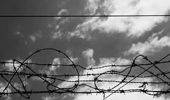 Prison (Vasilis Mantas) Tags: sky bw white black clouds canon athens greece prison 1740 select 2014 500d vmantas vmantasphotography