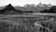 Homestead (Erazzphoto) Tags: blackandwhite mountains grass barn photography stream mormon grandtetons tetons mormonbarn