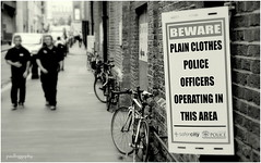 Ambiguity (paulbiggsphotography) Tags: city london sign warning blackwhite police crime ambiguity
