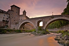 Ponte Fabricio, Rome. (James Whitlock Photography) Tags: travel bridge sunset sky bw italy cloud sun rome colour brick canon river fire rocks long exposure 110 sigma ponte 7d rays 1020 fabricio beams