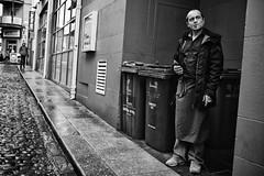 Decisive Moment (Ross Magrath) Tags: street camera city ireland winter portrait bw dublin irish white black colour wet face