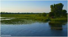 Canoe Gathering (jhumbrachtphotography) Tags: lake landscape spring canoe