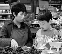 Packing Blackberries (Coral Norman) Tags: candid familyportait blackandwhite familybusiness portrait granvilleisland market berries produce fruit momandson son mom