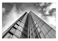 skywards (handheld-films) Tags: london canarywharf business building skyscrapers architecture architectural towering financial centre center glass modern contemporary geometry geometrical city tower sky cloud ambition striving mono monochrome blackandwhite