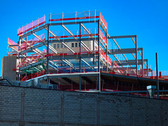 The Construction Kit (Steve Taylor (Photography)) Tags: art architecture building construction fence scaffold scaffolding red blue grey green steel metal newzealand nz southisland canterbury christchurch cbd city lines wall beam ibeam chimney ducting rebuild