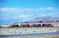 ATSF 8738-8715-8734-5542, Laguna, NM. 1-08-1980 (jackdk) Tags: train railroad railway locomotive ge gelocomotive u36c atsf santafe freighttrain freight emd emdsd45 sd45