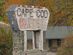 Cape Cod Motel (BadBlackdog9) Tags: roadside roadsideamerica americana oldfashioned oldsigns sign vintage abandoned motel newyork fingerlakes