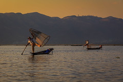 Fishermen in the late afternoon, Inle Lake, Myanmar (Kenneth Back) Tags: inlelake myanmar sunset fishermen fisherman shan myanmarburma mm colors boats cages canoes