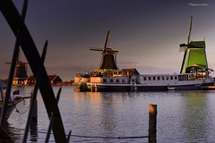 Windmills in Zannse Schans, where you can feel the peace and serenity. (marcootero_) Tags: sunset sea landscape pretty sunlight water beach blue mar río holanda molinos molens windmills nubes clouds nikon barco boats river