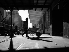 Build the building (danielsteuri) Tags: danielsteuri switzerland world streetphotography olympus omd em10 mft microfourthird 14mm 45mm blackwhite bw candid moments moment creativecommons explore scout bestcamera primelens portrait scene scenery strassenfotografie fotografie city snap photography street unposed crop streetmonkey flowingones