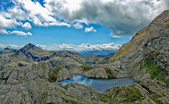 Laghi di Sopranes (explored) (Simple_Sight) Tags: lakes italy hiking mountains outdoors landscape blue green water sky clouds plants