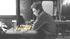 It's Just not Checkers... (innpictime ζ♠♠ρﭐḉ†ﭐᶬ₹ Ȝ͏۞°ʖ) Tags: cambridge pub bar scarf kingstreet beer customers chequers greeneking blackwhite champ championofthethames saloonbar etchedwindow abbotale chess chessboard checked game boardgame drinkers checkedscarf studious