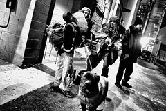 N Garland Ct. 11pm. Friday Night. (draketoulouse) Tags: chicago loop street streetphotography blackandwhite monochrome people city urban night dog kids homeless panhandlers light contrast alley
