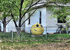 Smile Buoy! (Eyellgeteven) Tags: buoy smile smiley buoyant float floater yellow round happy smileyface face retired rural yardart yard decoration decorations decorated weird unusual strange bizarre funny repurpose fencedin chainlink house anthropomorphic rust rusty rusted rustyandcrusty ball water pareidolia