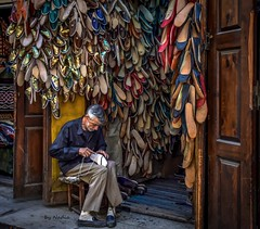 Keeping traditions alive (Nadia Rifaat) Tags: tradition old cairo egypt leather slippers nikon d5300 18140mm street photography people man work