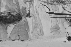 Sands of Time (brucetopher) Tags: beach sand time erosion decay black white blackandwhite bw blackwhite monochrome contrast tone tones erode clock natural hourglass nature sandsoftime sands cliff fall flow pattern feet foot base dune dunes