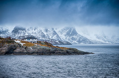 Travel and Tourism Concepts. One Separate House on Seashore Coastline in Norway Against Snowy Mountains. (DmitryMorgan) Tags: norway norwegian panorama scandinavia arctic bay coast environment europe fjord hamnoy harbor house hut isle light lofoten lofotenislands mountains nature nopeople noone ocean outdoor picturesque polarcircle red reddish reine reinefjord scenery scenic seascape snowy traditional traveldestination travelling village water