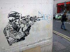 Walking AND texting?  die mother (nolionsinengland) Tags: soldier stencil gun passerby endless singlelayer