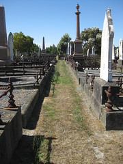 Looking down a Row of Graves at Old Ballaarat Cemetery -  Corner Macarthur Street and Creswick Road, Ballarat (raaen99) Tags: city detail history monument cemetery grave graveyard statue stone neglect dead death sadness sad mourning decay headstone neglected masonry 19thcentury victorian australia victoria morte victoriana burial historical classical weathered churchyard marble statuary tod decaying ballarat dood mourn nineteenthcentury countryvictoria macarthurst lamorte macarthurstreet provincialvictoria ballaratcemetery creswickroad oldballaratcemetery oldballaaratcemetery lextonstreet lextonst creswickrd pigahst pigahstreet