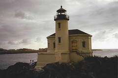 Coquille River Lighthouse (2 of 2) [scanned] (jimsawthat) Tags: lighthouse architecture clouds oregon carolyn ryan scanned bandon 1990s smalltown pacificcoast architecturaldetails