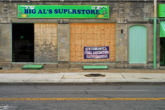 Indy#16045_Copy (Single-Tooth Productions) Tags: storefront abandoned abandonedstorefront outofbusiness boardedupstorefront buildingstreetview boardedupwindows architecture architecturaldetail architecturaldecay decaying bleak neglect architecturalcomposition composition shapes lines colorblocks 2d flat banner advertising bigalssuperstore bigals flagstone flagstonefacade facade facadedetail ncollegeave indianapolis indiana urban city building buildingdetail buildingcomposition buildingdecay urbandecay 50mm nikkor nikkor50mm nikond200 nikon