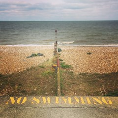 Aww, why not? (vapour trail) Tags: whitstable kent coast town beach sea horizon swimming sign letters no seaside