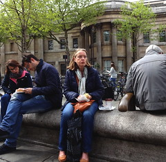 Woman sitting on a wall (Snapshooter46) Tags: woman people sitting sittingonawall snacking london