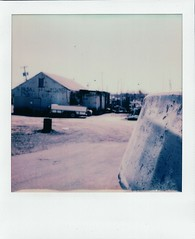 Shoal Harbor Fishery (thereisnocat) Tags: impossibleproject beta sx70 polaroid beta30color fishery boat belford middletown monmouthcounty newjersey nj