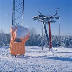 Turning of the ski lift (swedish silver) Tags: cinestill medium format alpha hasselblad 500cm ski snow skislope color colour bleed gi spill light imacon