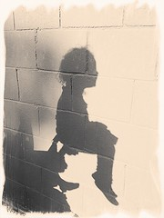 Sun, Meet My Daughters (snorkie128) Tags: stroller wall cinderblock shadow happy sunlight