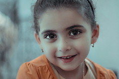 Tunisian Little Girl (EEAworkshop) Tags: portrait kids child girl baby kid beautiful tunisian tunisia traditional jewelry eyes face closeup smile model colors colorful light indoor people indoors nikon art artistic naturallight arabic arab arabian beauty pretty faces 50mm 18g ngc