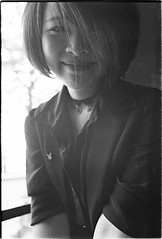 Avalanche (dzunglv) Tags: portrait bnw blackandwhite hanoi asian vietnam window sunlight light contrast shorthair eye eos3 ef50mm18stm fade smile candid girl lady black shadow art friend cafe people new monochrome analogue film