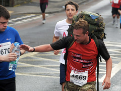 Sheffield Half Marathon 2014: Sharing Water (Tim Dennell) Tags: marathon sheffield half runner 2014 yahoo:yourpictures=sharing