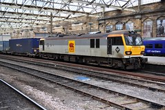 92024 J. S. Bach, passing through Carlisle, on a container train. (Raymondo166) Tags: travelling station electric train four j mixed citadel no platform railway s brush class container bach locomotive passing through carlisle 92 named manufactured called livery ews 024 92024 liveried