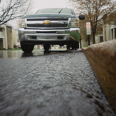Torrential rains are coming (Thiophene_Guy) Tags: film water rain iso800 kodak gutter splash curb forcedperspective lowperspective originalworks groundperspective floorperspective thiopheneguy may2014 photosinthegutterproject