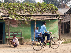 Village life (Dick Verton ( more than 13.000.000 visitors )) Tags: blue green sitting streetlife streetscene sit streetview bycicle streetshot schoolboys