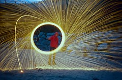 Light Painting with Wire Wool (imogencallaway) Tags: longexposure lightpainting film beach wool night 35mm fire sticks lomo lca lomography wire long exposure glow time spinning sparks whisk 800iso