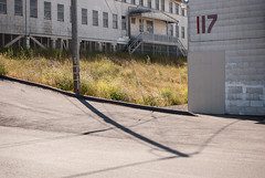 117 (Super G) Tags: color building pole hunterspoint 117 hunterspointnavalshipyard nikon218