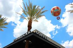 Starbucks - Downtown Disney West Side 060514 (Little_Karen) Tags: summer sky june clouds florida balloon coffeeshop disney palmtrees starbucks hotairballoon downtowndisney starbuckscoffee downtowndisneywestside charactersinflight
